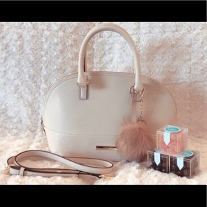 purse with body strap and puff